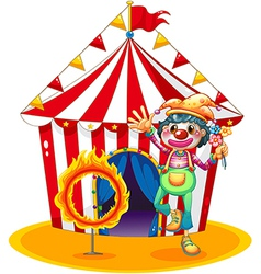 A ring of fire and a clown in front of a circus vector image