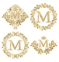 Golden letter m vintage monograms set heraldic vector