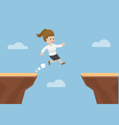 businesswoman jump through the gap between cliff vector image