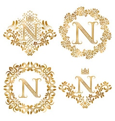 Golden letter n vintage monograms set heraldic vector