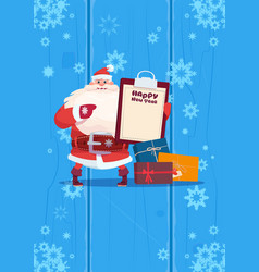 santa claus hold present list on happy new year vector image vector image