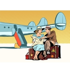 Tourists couple looking at the map after landing vector