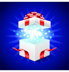 Opened gift box on blue background vector image vector image
