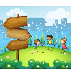 Three kids playing in the hill with wooden vector