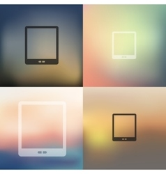 Tablet icon on blurred background vector