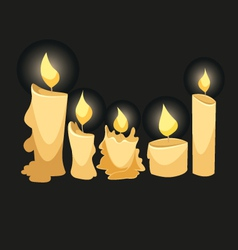 Set of candles isolated on a black backgrounds vector