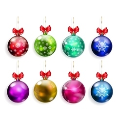 Set of multicolored christmas balls with red bows vector