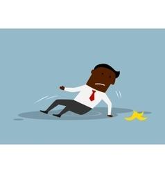 Cartoon businessman slipped on a banana peel vector