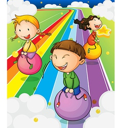Three kids playing with the bouncing balls at the vector image vector image