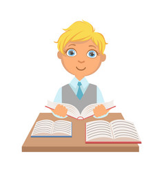 Elementary school student sitting at the desk and vector