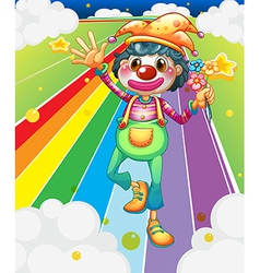 A female clown with flowers at the colorful road vector image