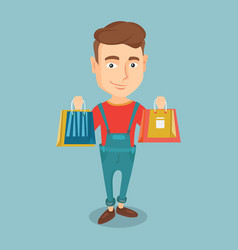 Happy man holding shopping bags vector