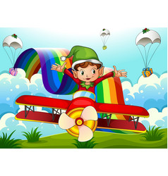 A plane with an elf and a rainbow in the sky with vector image