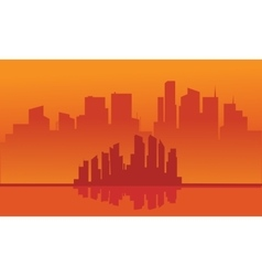 Silhouette of city with orange background vector