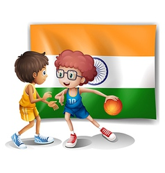 Two boys playing basketball in front of the Indian vector image