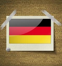 Flags germany at frame on a brick background vector