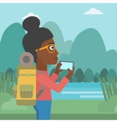 Woman with backpack taking photo vector