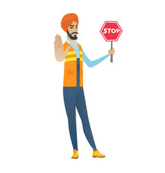 Young hindu builder holding stop road sign vector