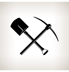 Crossed shovel and pickaxe vector