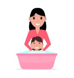 cartoon mother bathes a baby vector image