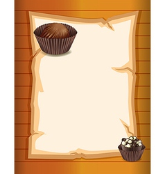 An empty stationery with two chocolate cupcakes vector