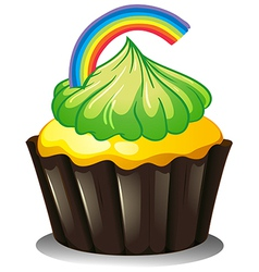 A cupcake with a green icing vector