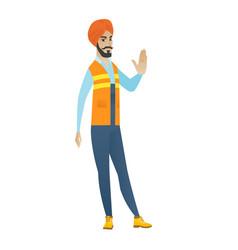 Young hindu builder showing stop hand gesture vector