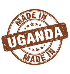 made in uganda brown grunge round stamp vector image