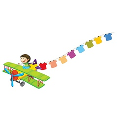 A boy in a plane with hanging clothes vector