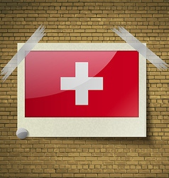 Flags switzerlandat frame on a brick background vector