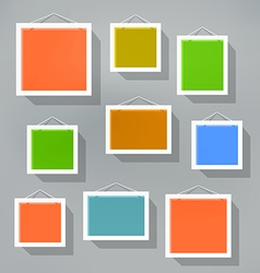 Blank color picture frame set on blured background vector image