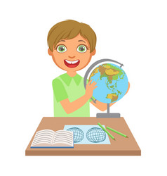 Little boy studying geography with globe on study vector