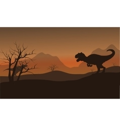 Silhouette of allosaurus in hills at afternoon vector