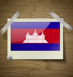 Flags cambodia at frame on wooden texture vector