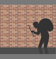 Burglar in front of brick wall vector