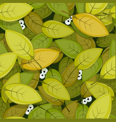 Animal eyes inside green leaves seamless vector
