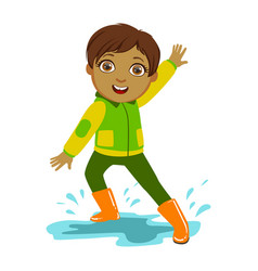 boy in green and yellow jacket kid in autumn vector image