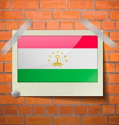 Flags tajikistan scotch taped to a red brick wall vector