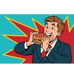 Pop art man eating a Burger vector image vector image