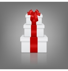 Stack of three realistic white gift boxes with red vector