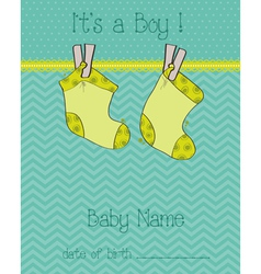 Baby boy arrival card with socks vector