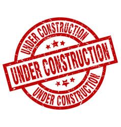 Under construction round red grunge stamp vector