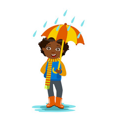 Boy with open umbrella standing under raindrops vector