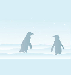 Silhouette of penguin on snow landscape vector