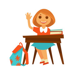 Cheerful little girl sits at desk in school vector