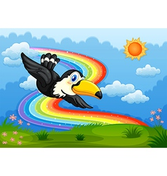 A bird in the sky with a rainbow vector