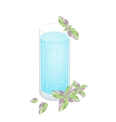 A glass of blue drink with ice cubes vector