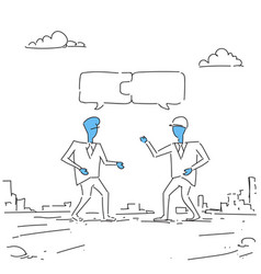 two businessmen collecting puzzle teamwork vector image