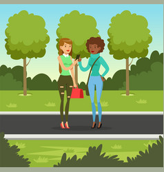 Two girlfriends talking while walking in the park vector