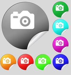 Photo camera icon sign set of eight multi-colored vector